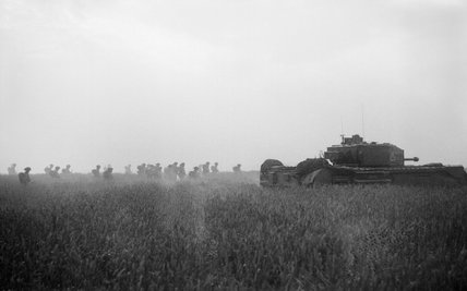 Infantry of 6th Royal Scots Fusiliers, 15th (Scottish) Division, advance behind a Churchill tank of 9th Royal Tank Regiment at the start of Operation 'Epsom' in Normandy, 26 June 1944.
