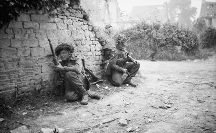 Men of 12 Platoon, 'B' Company, 6th Royal Scots Fusiliers take cover in St Manvieu during Operation 'Epsom', Normandy,  26 June 1944.