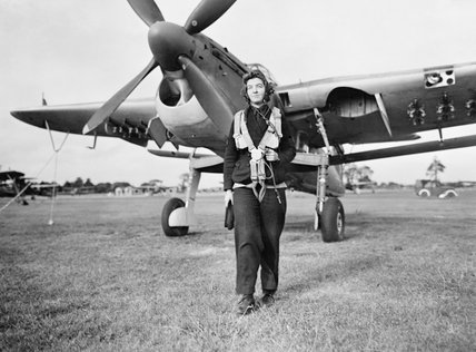 A Women's Royal Naval Service radio mechanic walks from a  Fairey Barracuda torpedo bomber at RNAS Lee-on-Solent, September 1943.