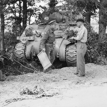 Major General George 'Pip' Roberts (right), commanding 11th Armoured Division, with Brigadier Roscoe Harvey of 29th Armoured Brigade, and a Sherman command tank, Normandy, 15 August 1944.