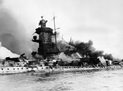 The German pocket battleship ADMIRAL GRAF SPEE in flames after being scuttled off Montevideo, Uruguay, after the Battle of the River Plate, 17 December 1939.