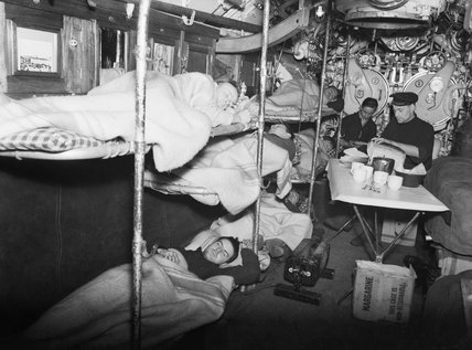 The crew rest on board the Dutch submarine O-14, January 1942.