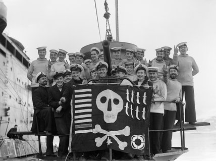 The crew of HM Submarine UTMOST displaying their