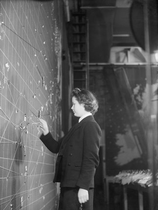 A Women's Royal Naval Service plotter at work in the Operations Room at Derby House in Liverpool, the headquarters of the Commander-in-Chief Western Approaches, September 1944.