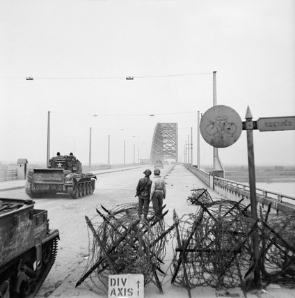 Cromwell tanks of 2nd Welsh Guards crossing the bridge at Nijmegen in Holland during Operation 'Market Garden', 21 September 1944.