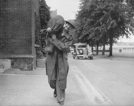 A new recruit to the Militia having just been issued with his kit, July 1939.