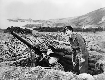 Men of the Royal Navy's Coast Watch man a Lewis gun emplacement on a cliff top in Devon, 1940.