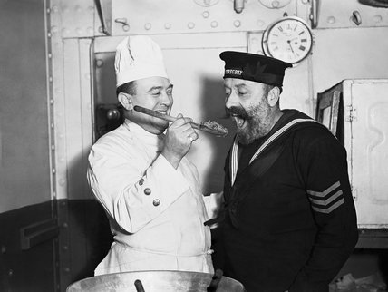 Tasting the Christmas pudding aboard HMS COCHRANE, November 1940.
