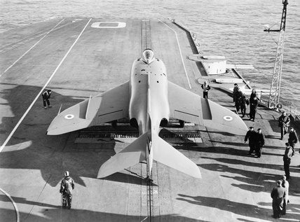 The pre-production Supermarine Scimitar strike fighter about to be launched from HMS ARK ROYAL during carrier trials in the English Channel, 6 January 1957.