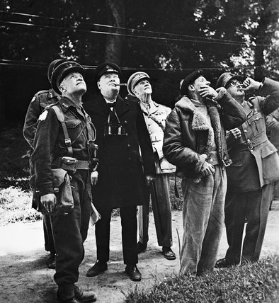 Winston Churchill and senior Allied commanders looking up at aircraft activity overhead during a visit to General Montgomery's headquarters in Normandy, 12 June 1944.