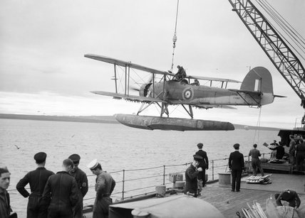 A Fairey Swordfish being hoisted aboard HMS MALAYA, October 1941.