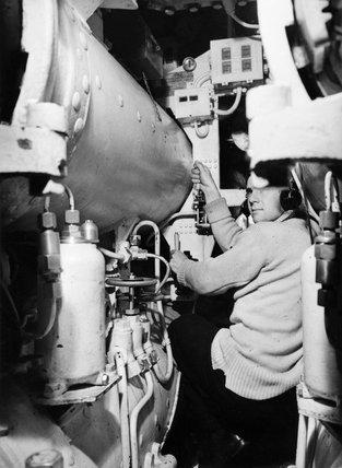 A seaman operates the torpedo firing controls in the Polish submarine SOKOL (FALCON), 31 March 1944.