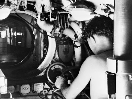 A submariner at the controls of a Royal Navy midget submarine in Sydney, Australia, 1945.