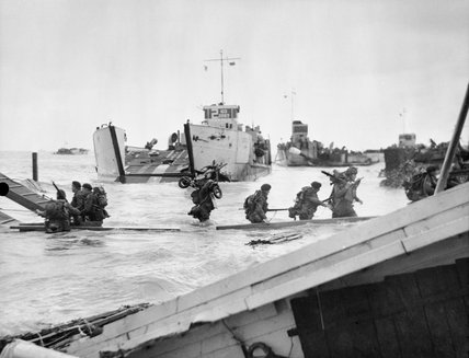 Commandos of 48 (RM) Commando coming ashore from landing craft at St Aubin-sur-Mer on Juno Beach, 6 June 1944.