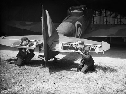 Ground staff examine the damage to the elevators of a Boulton-Paul Defiant Mk I of No. 264 Squadron RAF at Duxford, following a battle with German fighters over Dunkirk, 29 May 1940.