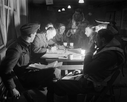 The crew of a Short Stirling bomber of No. 622 Squadron RAF being debriefed by the intelligence officer at Mildenhall, Suffolk, after returning from the major raid on Berlin of 22/23 November 1943.