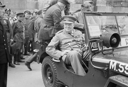 Winston Churchill in a jeep outside the German Reichstag during a tour of the ruined city of Berlin, 16 July 1945.