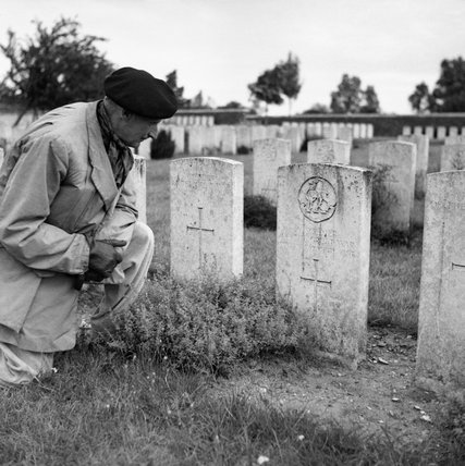 Field Marshal Montgomery reads the inscription on a grave at the Canadian First World War memorial at Vimy Ridge, 8 September 1944.
