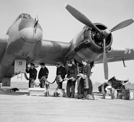 Bristol Beaufighter Mk VIF of No. 96 Squadron RAF being re-armed at Honily, Warwickshire, 23 March 1943.