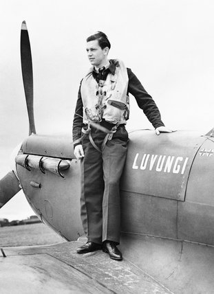 Pilot Officer H. A. Picard of No. 350 (Belgian) Squadron, on the wing of his Spitfire at Kenley, July 1942.