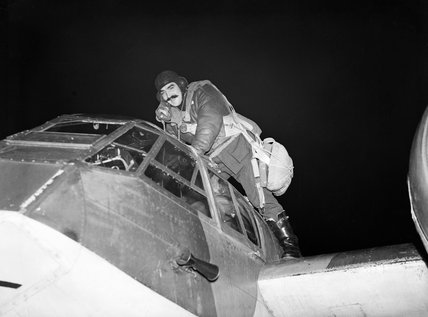 Pilot Officer Peter Kells, the pilot of a Blenheim Mk IF of No 29 Squadron, climbs into his cockpit at the start of another night patrol from Coleby Grange, Lincolnshire, October 1940.