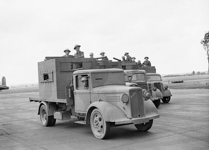 RAF personnel man armoured trucks used for airfield defence at Wyton, Cambridgeshire, July 1940.