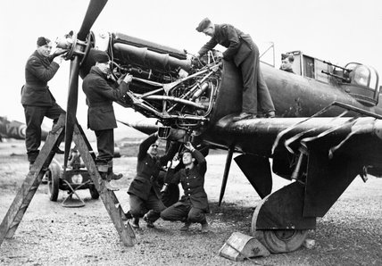 Fitters working on the Rolls-Royce Merlin engine of a Boulton Paul Defiant of No. 125 Squadron RAF at Fairwood Common, Wales, January 1942.
