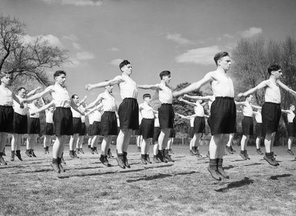 New recruits undertake physical training at a Royal Air Force Initial Training Wing, 2 May 1942.