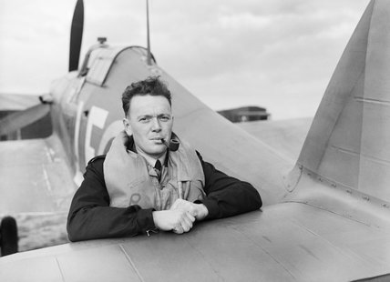 Flight Lieutenant P S Turner of No. 242 Squadron RAF, rests on the tail elevator of his Hawker Hurricane Mk I, after landing at Fowlmere, near Duxford in Cambridgeshire, September 1940.