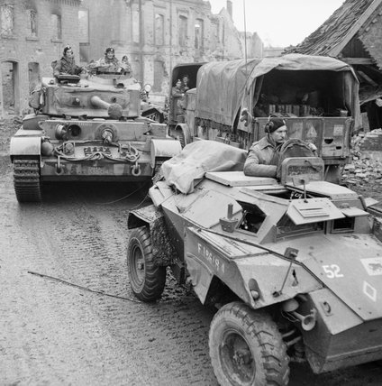 A Humber scout car and Comet tank of 11th Armoured Division in a devastated German town, 30 March 1945.