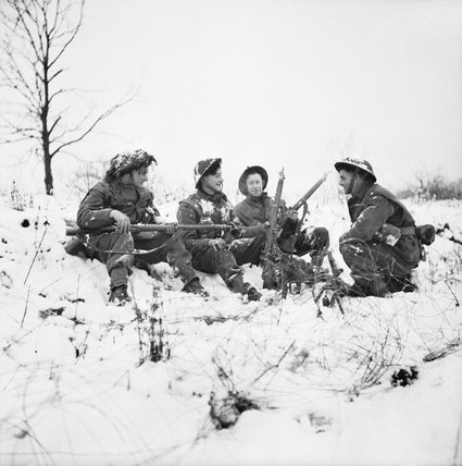 Infantry of 53rd (Welsh) Division in the snow near Hotton, Belgium, 4 January 1945.
