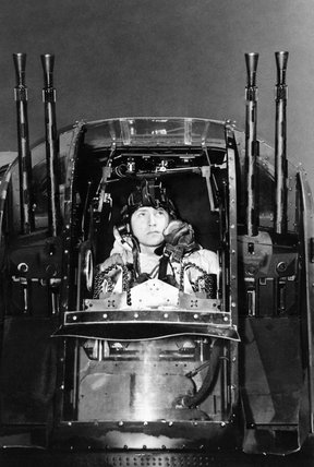 Flight Sergeant J Morgan, the rear gunner of an Avro Lancaster of No. 630 Squadron RAF at East Kirkby, Lincolnshire, checks his guns before taking off on a night raid on the marshalling yards at Juvisy-sur-Orge, France, 18 April 1944.