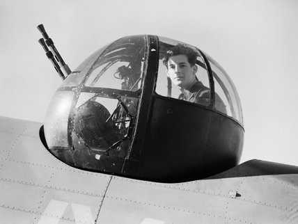 Leading Aircraftman Walter 'Spike' Caulfield in the turret of a Lockheed Hudson of No 206 Squadron, June 1940.