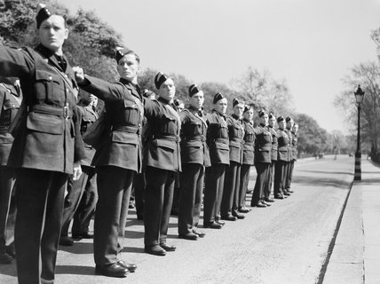 Aircrew cadets adjust their parade dressing at an RAF Initial Training Wing in the UK, May 1943.