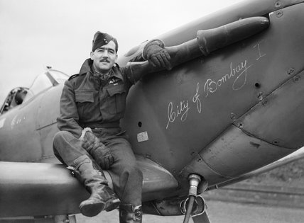 Squadron Leader H J L Hallowes, CO of No. 122 Squadron, with his Supermarine Spitfire Mk V at Scorton in Yorkshire, December 1941.