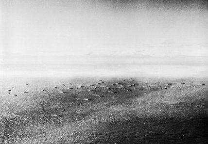 An aerial view of a convoy in the Atlantic, 1941. Two escorts can be seen in the foreground.