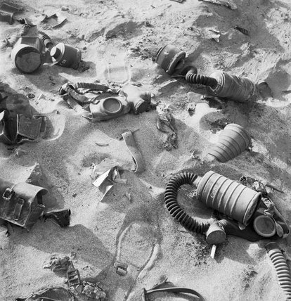 A Cecil Beaton photograph showing Italian gasmasks abandoned in the Western Desert during 1942.