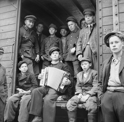 Russian displaced persons and former prisoners of war about to leave transit camps near Hamburg for the Russian zone of occupation from where they will be repatriated to the Soviet Union, 31 May 1945.