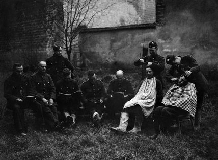 RAF personnel at an improvised 'barber's shop' in France, 1939.