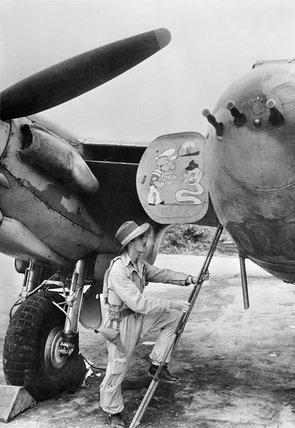Flight Lieutenant A Torrance of 'A' Flight, No. 27 Squadron RAF, climbs into his de Havilland Mosquito FB VI at Parashuram, India, for a sortie over Burma, March 1944.