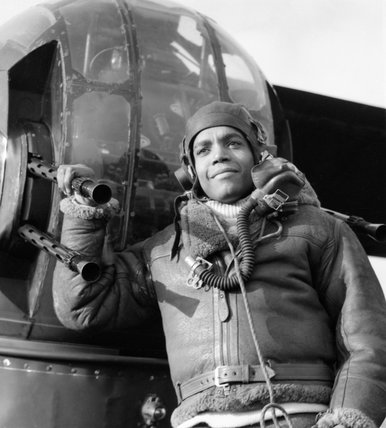 Sergeant Lincoln Orville Lynch DFM, a West Indian air gunner serving with No. 102 Squadron, by the rear turret of his Halifax at RAF Pocklington, February 1944.