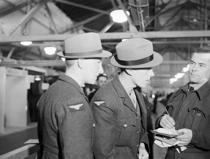 RAF aircrew training cadets take part in a demobilisation rehearsal at a civilian clothing centre in Wembley, 17 October 1944.