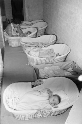 Babies in the basement air raid shelter of the 'Foster Parents Plan for War Children' Nursery in Hampstead, London, 1941.