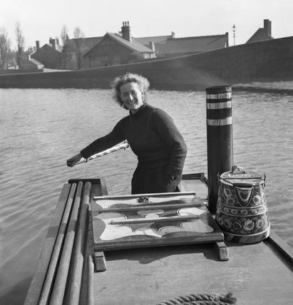Miss March manning the tiller of the narrowboat 'HEATHER BELL' nas it carried flour from Worcester to Tipton during 1942.</br></br></br>