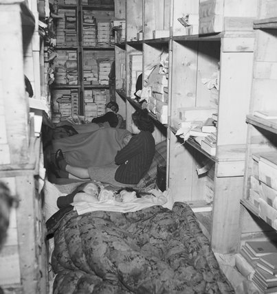 Londoners spending the night in the basement of a book store in Bloomsbury, London during the Blitz of 1940.
