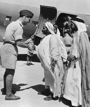 Air Commodore Whitney Straight, Air Officer Commanding RAF Transport Command, Middle East, saying goodbye to the Sheikh Khalifa, cousin of the ruler of Bahrain, and his two sons, 18 January 1945.