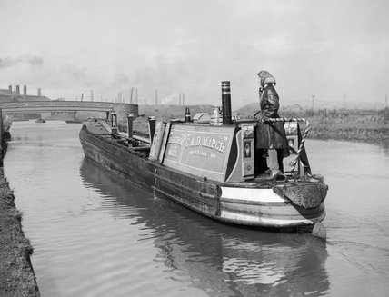 The narrowboat, 'HEATHER BELL' heads for the collieries through the industrial Midlands to collect a fresh cargo during 1942.