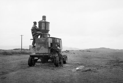 Leading Aircraftman G Bidwell (left) and Corporal W Jones carry out maintenance work on an RAF mobile lighthouse at Mull of Oa, Islay, September 1945.