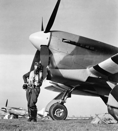 Flying Officer J R Cullen of No. 486 Squadron RNZAF, standing in front of his Hawker Tempest Mk V at Castle Camps, Cambridgeshire, 8 April 1944.