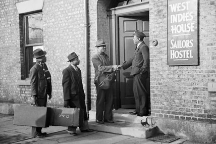Three West Indian Merchant Seaman are welcomed by the warden of a hostel in Newcastle-Upon-Tyne in 1941.